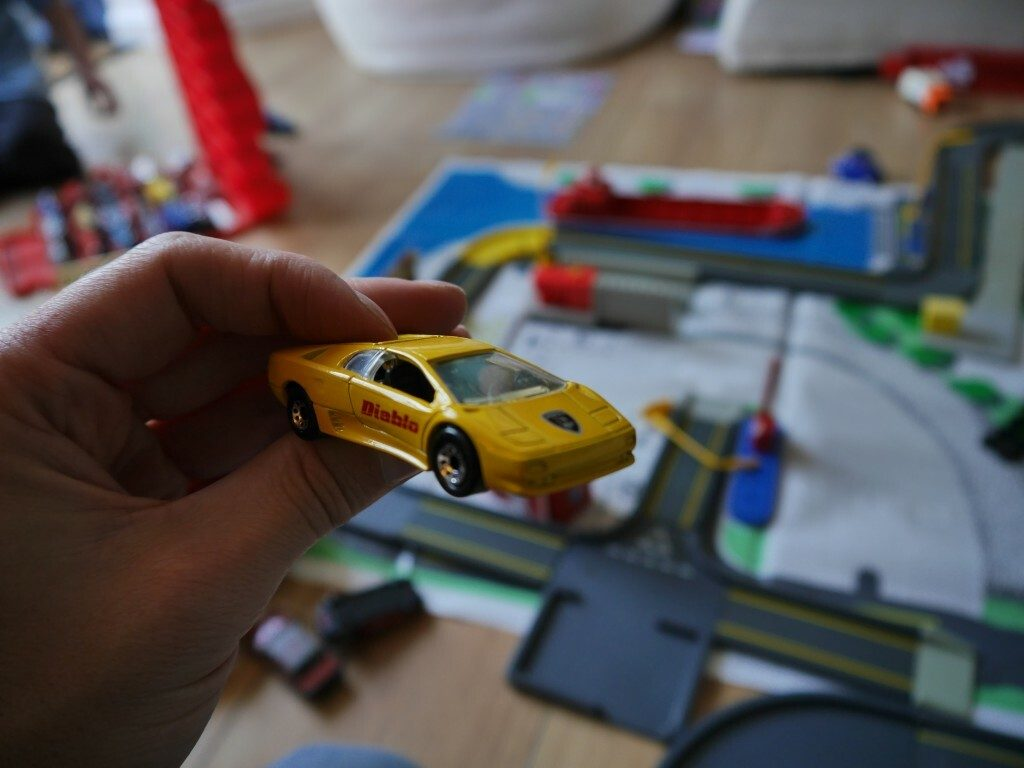 Lamborghini Above a Matchbox City