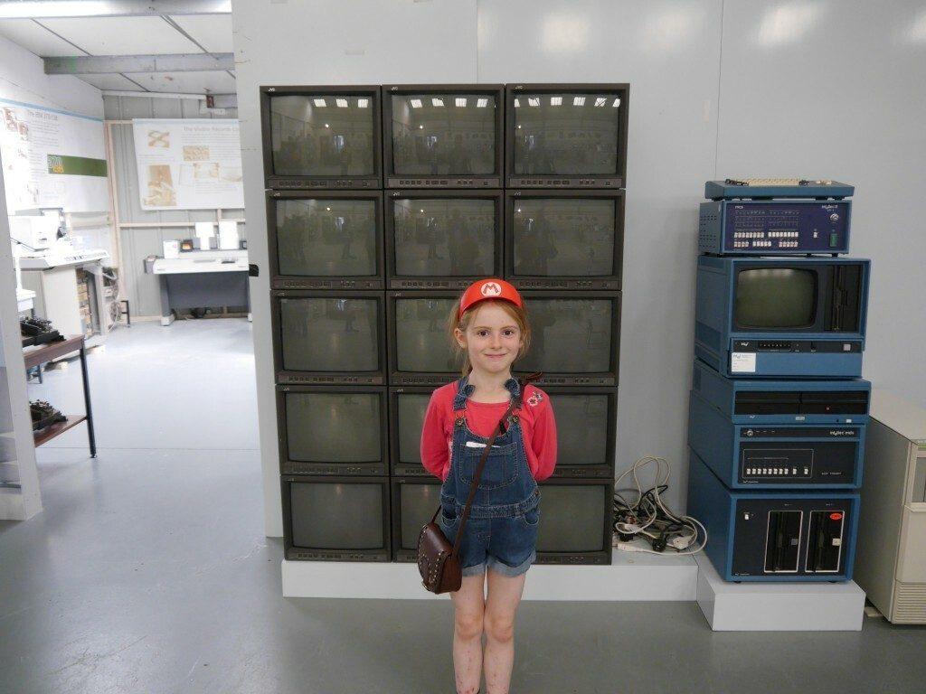 Child and a bank of monitors
