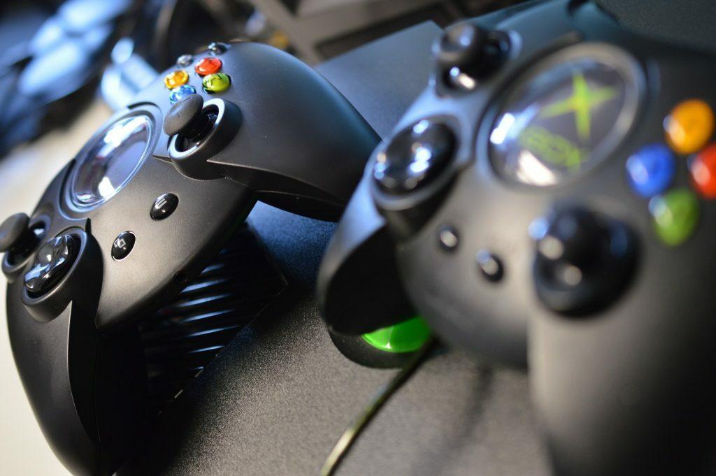 Original Xbox Duke pad next to a Hyperkin Duke