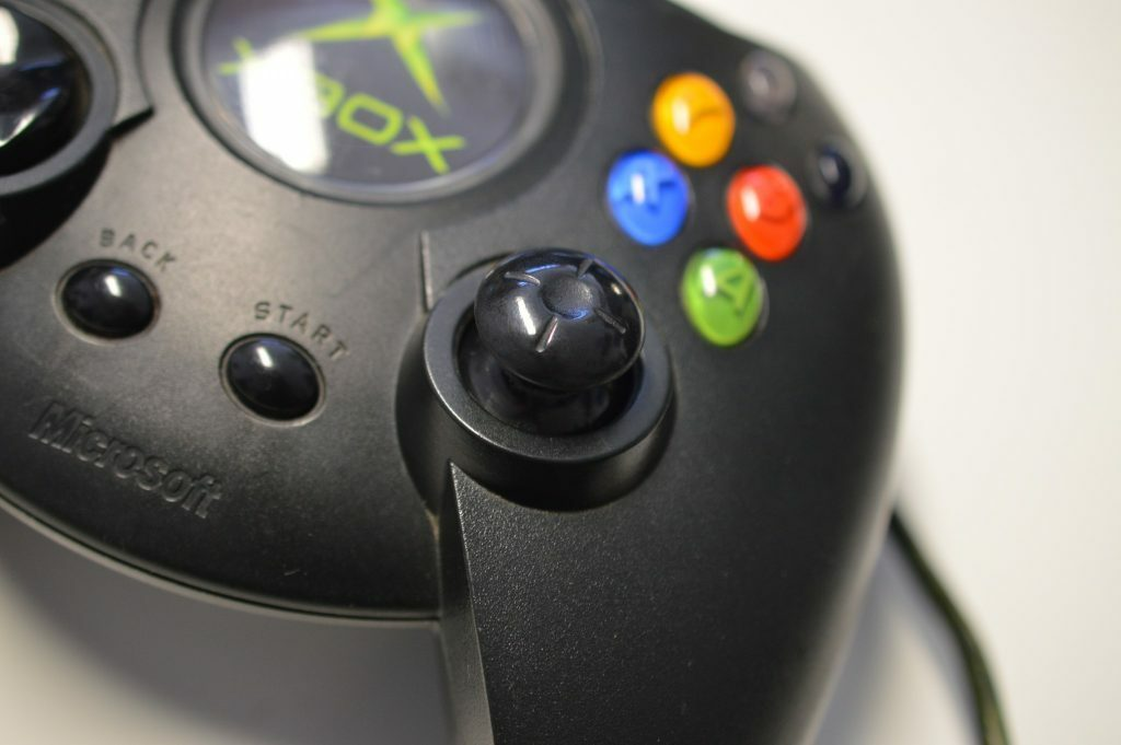 Close up of original Xbox Duke controller, showing buttons and cord